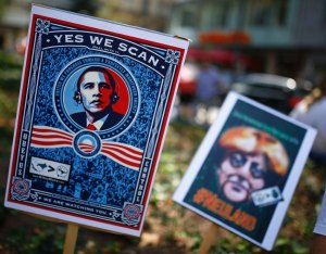 Placards showing U.S. President Obama and German Chancellor Merkel are seen during demonstration against NSA and in support of Snowden in Frankfurt