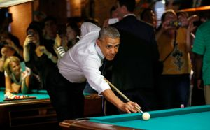 U.S. President Obama shoots pool during stop in a bar in Denver